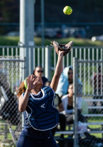Kennedy's Shyan Perez #11 catches the ball in front of home plate, during a Girls NVL Softball game between WCA and Kennedy at Roberto Clemente Field in Waterbury on Wednesday. Bill Shettle Republican-American