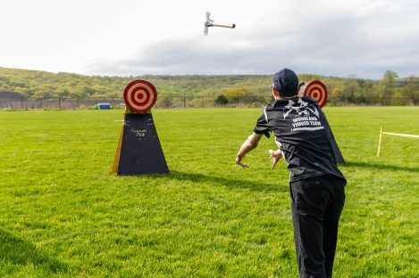 Woodland senior John D'Amico throws an axe at the target during the axe throwing portion of a Timber team competition between Wamogo and Woodland at Woodland Regional High School in Beacon Falls on Friday. Bill Shettle Republican-American