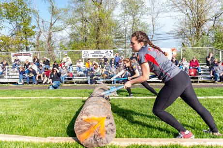 Wamogo timber team members Melissa Demitri, and Isabella Giansanti, behind, move a very large log of wood, during a Timber team competition between Wamogo and Woodland at Woodland Regional High School in Beacon Falls on Friday. Bill Shettle Republican-American