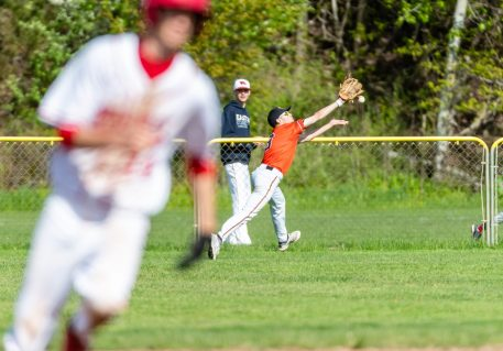 Watertown's Zackary Fenn #9 reaches out trying to catch fly ball to right field, during a NVL Baseball game between Watertown and Wolcott at Wolcott High School in Wolcott on Wednesday. Bill Shettle Republican-American
