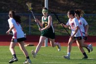 Holy Cross' Katelyn Honegger (6) looks to get through the Watertown defense during their lacrosse match Wednesday at Watertown High School. Jim Shannon Republican American