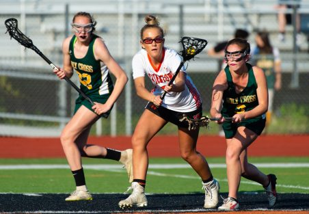 Watertown's Hannah Mehlin (7) gets control of the ball in front of Holy Cross' Camille Perron (3) and Alyssa Hebb (22) during their lacrosse match Wednesday at Watertown High School. Jim Shannon Republican American