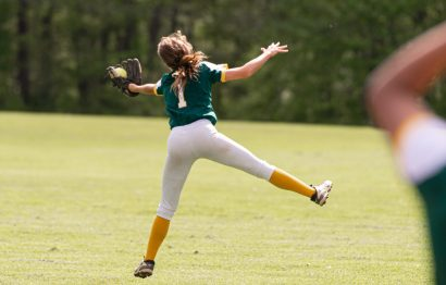 Holy Cross' Allie Brown (1) makes an acrobatic catch for the out during their NVL game against Seymour Thursday at Holy Cross High School. Jim Shannon Republican American