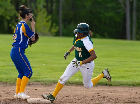 Holy Cross' Brianna Greenlaw (11) rounds second base past Seymour's Lauren Haversat (2), on a base hit by Carley DeFoe (26) during their NVL game Thursday at Holy Cross High School. Jim Shannon Republican American