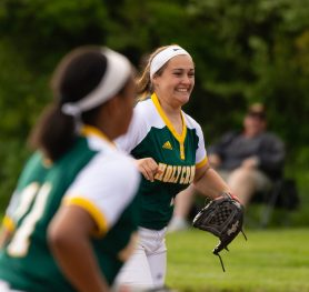 Valerie Nobrega (25) is all smiles after catching a pop up to end their NVL game against Seymour Thursday at Holy Cross High School. Jim Shannon Republican American