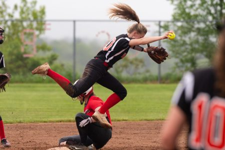 Northwestern's Ellie Olsen (15) breaks up a double-play attempt by Wamogo's Savannah Wheeler(20) during their Berkshire League game Monday at Northwestern. Jim Shannon Republican American