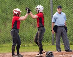 Northwestern's Jana Sanden (19), right, is congratulated by teammate Ellie Olsen (15) after hitting a two-RBI home run during their Berkshire League game against Wamogo Monday at Northwestern. Jim Shannon Republican American