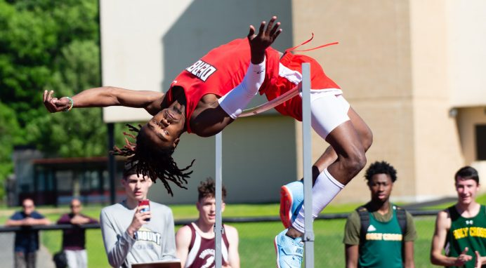 "Derby's Ja'Kwan Hale attempt to clear 6'10 1/4"" for the NVL high jump record during the NVL Track and Field Championships held Tuesday at Torrington High School. Hale did not clear the height but won with a jump of 6'9"" Jim Shannon Republican American"