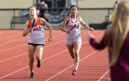 Watertown's Emma Zaccagnini overtook Naugatuck's Rachel Huculak on the anchor leg to help her team win the 4x400m relay during the NVL Track and Field Championships held Tuesday at Torrington High School. Jim Shannon Republican American