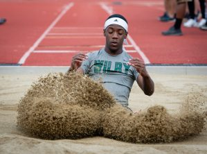 Wilby's Leonardo DaGraca kicks up some sand while competing in the triple-jump during the NVL Track and Field Championships held Tuesday at Torrington High School. Jim Shannon Republican American