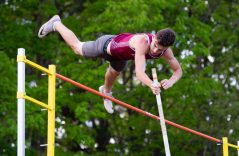 "Naugatuck's Zach Koslosky clears 12' 6"" while competing in the pole vault during the NVL Track and Field Championships held Tuesday at Torrington High School. Jim Shannon Republican American"