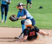 Watertown's Makayla Beauty (25) slides in for a double in front of the tag by Oxford's Maddie Sastram (27) during their NVL tournament semifinal game Wednesday at Seymour High School. Jim Shannon Republican American