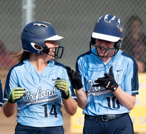 Oxford's Kaylee Dolan (14) and Molly Sastram (10) celebrate their win over Watertown in their NVL tournament semifinal game Wednesday at Seymour High School. Jim Shannon Republican American