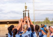 The Oxford girls softball team all hold up the championship trophy together after winning the Girls Softball NVL Championship game between Oxford and Seymour at Naugatuck High School in Naugatuck on Thursday. Oxford won in extra innings over Seymour 11-6 and wins the NVL Championship for 2019. Bill Shettle Republican-American