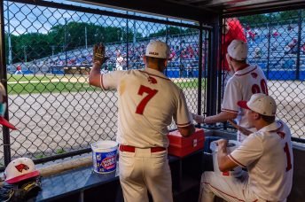 Wolcott players (l-r) Anthony Ligi #7, Matthew Northrop #1, and Kyle Hensel #30, cheer their team on from the dugout during the final inning of the NVL championship game between Holy Cross and Wolcott at Municipal Stadium in Waterbury on Friday. Wolcott beat Holy Cross 10-3 to win the 2019 NVL Baseball Championship. Bill Shettle Republican-American