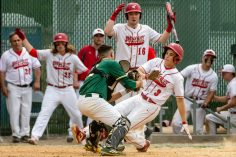 Wolcott's Dane Hassan #3 is tagged out trying to score a run at home plate by Holy Cross' Brian Parzyck #33, during the NVL championship game between Holy Cross and Wolcott at Municipal Stadium in Waterbury on Friday. Wolcott beat Holy Cross 10-3 to win the 2019 NVL Baseball Championship. Bill Shettle Republican-American