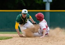 Holy Cross' Will Greene #3, left, tags out Wolcott's Tom Marciano #14, going to second, during the NVL championship game between Holy Cross and Wolcott at Municipal Stadium in Waterbury on Friday. Wolcott beat Holy Cross 10-3 to win the 2019 NVL Baseball Championship. Bill Shettle Republican-American