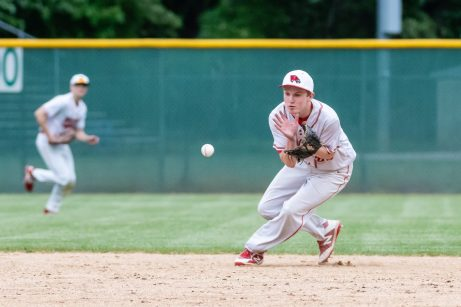 Wolcott's Reece Ketchum #22 makes a play on the ball hit to him, in the infield, during the NVL championship game between Holy Cross and Wolcott at Municipal Stadium in Waterbury on Friday. Wolcott beat Holy Cross 10-3 to win the 2019 NVL Baseball Championship. Bill Shettle Republican-American