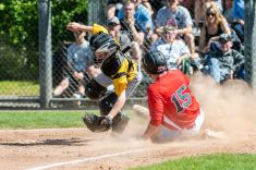 Amity catcher Jacob Crow #28, left, gets the force out at home and jumps out of the way of Cheshire's Ryan Strollo #15, sliding into home, during the SCC championship game between Amity and Cheshire at Piurek Field in West Haven on Saturday. Bill Shettle Republican-American