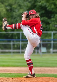Cheshire pitcher, with his high kick, Robert Roles #20, delivers a pitch from the mound, during the SCC championship game between Amity and Cheshire at Piurek Field in West Haven on Saturday. Bill Shettle Republican-American