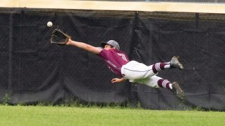 Naugatuck's Mike Patton (7) lays out to make a diving catch in center field during their Class LL first round tournament game against Brien McMahon Tuesday at Naugatuck High School. Jim Shannon Republican American