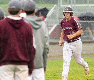 Naugatuck's Derrick Jagello (10) is greeted by teammates at home plate after blasting a solo home run in the sixth inning of their 2-0 win over Brien McMahon Tuesday at Naugatuck High School. Jim Shannon Republican American