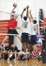 Cheshire High School's Aidan Godfrey sends the ball over the net as Cheshire battles Newington High School for the Class M boys volleyball title at Shelton High School on Thursday, June 6, 2019. Emily J. Reynolds. Republican-American