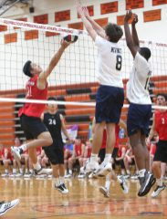 Cheshire High School's Yingpeng Tao saves the ball at the net as Cheshire battles Newington High School for the Class M boys volleyball title at Shelton High School on Thursday, June 6, 2019. Emily J. Reynolds. Republican-American