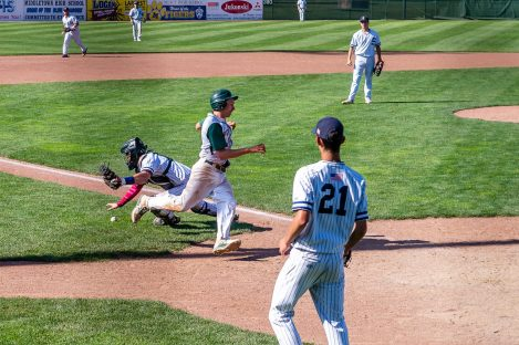Shepaug catcher Ethan Hibbard #3 can't handle the throw as Coventry's Jordan Jeroszko #9 runs by completing an inside the park home run, during the Class S Baseball Championship game between Coventry and Shepaug at Palmer Field in Middletown on Saturday. Coventry beat Shepaug 3-0. Bill Shettle Republican-American