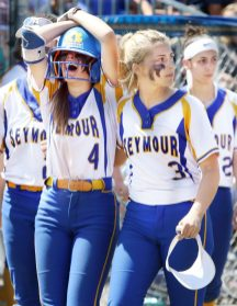 #4 Jacey Cosciello of Seymour High is comforted by #3 Alyssa Johnson as she reacts to the loss to Waterford in the Class M softball final in West Haven Saturday. Steven Valenti Republican-American