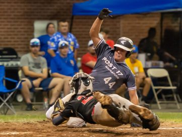 Cheshire catcher Andrew DeClement (22) makes a diving tag to get Naugatuck's Nick Delucia (44) out at home while trying to score during their American Legion baseball tournament game Monday at Ceppa Field in Meriden. Jim Shannon Republican-American