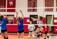 Pomperaug co-captain Megan Kennedy #7 spikes the ball over the net, during a girls volleyball scrimmage between Lewis Mills and Pomperaug at Pomperaug High School in Southbury on Thursday. Bill Shettle Republican-American