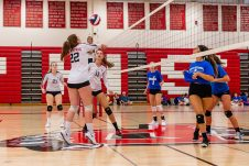 Pomperaug's Maggie Ferguson #22 gets ready to set the ball as teammates Lindsey Acarzua #11 and Jess Yager #21 look on, during a girls volleyball scrimmage between Lewis Mills and Pomperaug at Pomperaug High School in Southbury on Thursday. Bill Shettle Republican-American