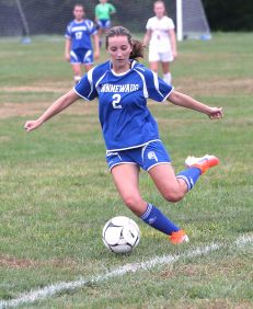 Nonnewaug High School's Alexa Burke keeps the ball in bounds during the girls varsity soccer game against Northwestern High School in Hollow Park on Thursday afternoon. Emily J. Reynolds. Republican-American
