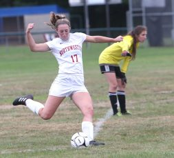 Northwestern High School's Jana Sanden kicks the ball up the field during the girls varsity soccer game against Nonnewaug High School Hollow Park on Thursday afternoon. Emily J. Reynolds. Republican-American
