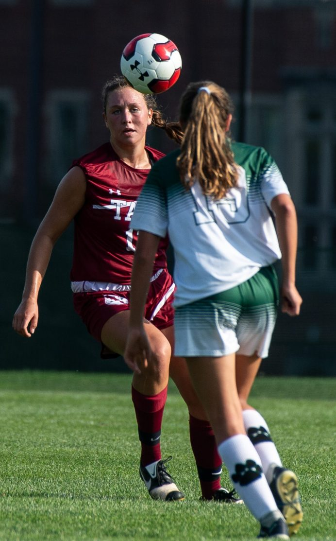 Taft's Elly MacKay (13) runs down a ball in front of Sacred Heart-Greenwich's Serna Fernanda (19) during their game Wednesday at the Taft School in Watertown. Taft defeated Sacred Heart 3-1. Jim Shannon Republican-American
