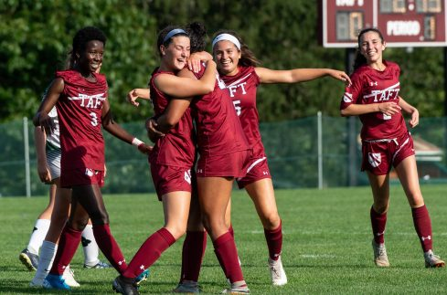 Taft players congratulate teammate Kayla Thomas (32) after she scored a goal in the first half of their game against Sacred Heart-Greenwich's during their game Wednesday at the Taft School in Watertown. Taft defeated Sacred Heart 3-1. Jim Shannon Republican-American