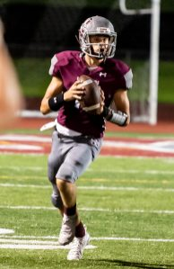 Naugatuck's Jay Mezzo (12) looks to pass during their season opening game against Wolcott Friday at Naugatuck High School. Jim Shannon Republican-American