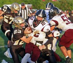 Torrington's Conrad Avallone (12) is tackled by Woodland's Andrew Shea (23) during NVL football action at Woodland High School Friday night. Michael Kabelka / Republican-American