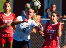 Oxford's Jess Kondic (8) and Wolcott's Samantha Riviezzo (2) battle for the ball during their game Tuesday at Wolcott High School Jim Shannon Republican-American