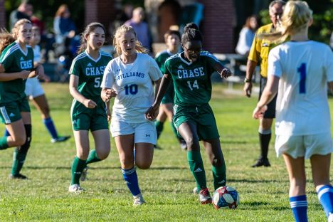 Chase's Ale Richard #14 runs down the field with ball with Williams player Sarah Cole #10 chasing from behind, during a soccer match between Williams and Chase Collegiate at Chase Collegiate on Wednesday. Bill Shettle Republican-American