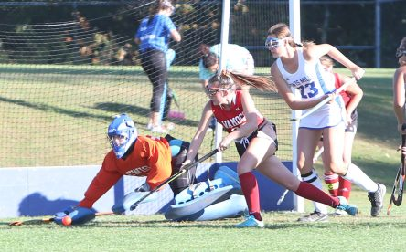 Lewis Mills High School goalie Hannah Markelon makes a diving save on a goal attempt by Wamogo High School's Julia Churyk during the girls varsity field hockey game at Lewis Mills on Wednesday afternoon. Emily J. Tilley. Republican-American