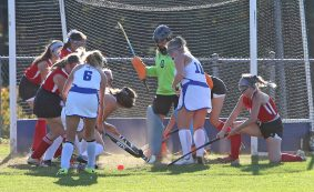 Members of the Lewis Mills High School and Wamogo High School field hockey teams battle in front of the Wamogo goal during the girls varsity game at Lewis Mills on Wednesday afternoon. Emily J. Tilley. Republican-American