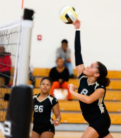 WCA's Emily Semedo (8) spikes the ball over the net during their NVL match-up with Naugatuck Tuesday at Waterbury Career Academy. Jim Shannon Republican-American