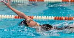 Sacred Heart's Clare Bussey took first place in the 100m backstroke with a time of 1:12:72 during their NVL meet with Watertown Tuesday at Watertown High School. Jim Shannon Republican-American