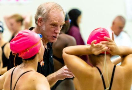 Watertown girls swimming head coach Garry Smith talks with his swimmers during their meet with Sacred Heart Tuesday at Watertown High School. Jim Shannon Republican-American