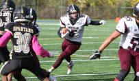 #5 Jacob Coleman of Torrington High looks for a hole while running against Waterbury Career Academy during football action in Waterbury Thursday. Steven Valenti Republican-American