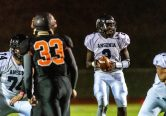 Ansonia quarterback Sheldon Schuler #2 drops back to pass, during a NVL game of the unbeaten between Ansonia and Watertown at Watertown High School on Friday. Bill Shettle Republican-American