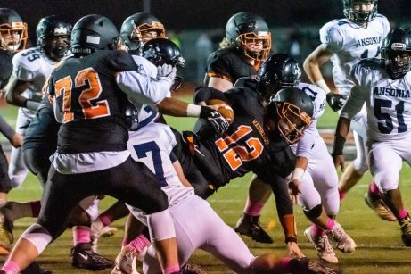 Watertown quarterback Xavier Powell (12) finds little running room as he is tackled by Ansonia's Tyler Cafaro #17, left, and Ansonia's Carlos Pinto #47, during a NVL game of the unbeaten between Ansonia and Watertown at Watertown High School on Friday. Bill Shettle Republican-American