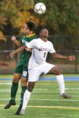 #18 Luke Zipoli of Holy Cross High and #9 Chris Akinduro of Naugatuck High battle for the ball during NVL Soccer action in Waterbury Monday. Steven Valenti Republican-American